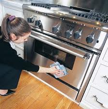 lady cleaning oven